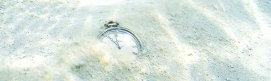 pocket_watch_buried_in_the_shallow_beach_AFR-IJ-14804