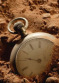 old_pocket_watch_buried_1774093
